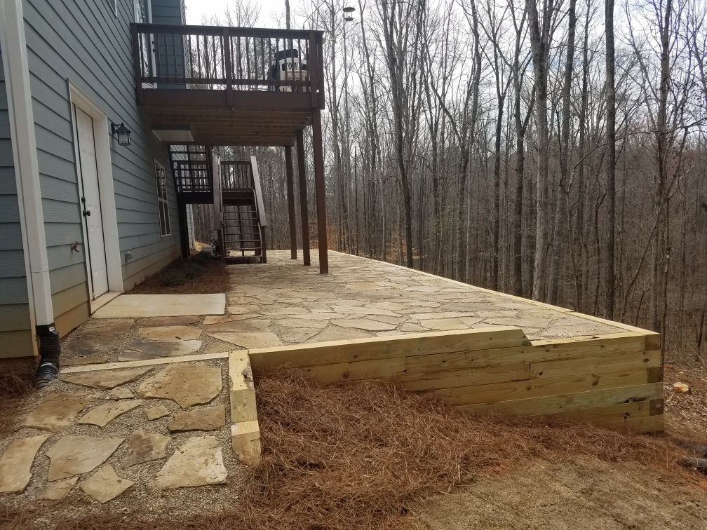 pressure treated wall with crab orchard patio